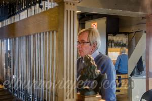 El hombre que toca el carillon del Belfort.